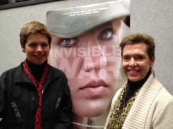 "Loree Sutton and Laurie Leitch in front of ""The Invisible War"" poster at the Sundance film festival"